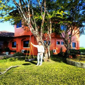 Man standing by home at Equus Village, Pedasi Panama – Best Places In The World To Retire – International Living
