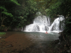 Waterfall in Azuero with man by it – Best Places In The World To Retire – International Living