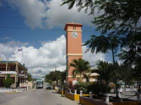 worst reasons to retire in Belize Street, park, and clock tower in Orange Walk Town, Belize – Best Places In The World To Retire – International Living