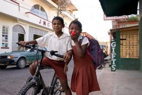 Belize boy and a bike and a girl – Best Places In The World To Retire – International Living