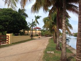 Sidewalk in Placencia, Belize, next to a canal – Best Places In The World To Retire – International Living