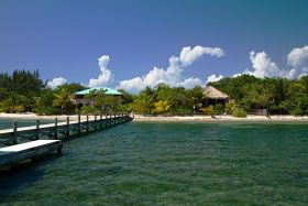 Placencia, Belize pier looking back towards shore – Best Places In The World To Retire – International Living