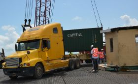 container being moved from a barge at the Port of Belize – Best Places In The World To Retire – International Living