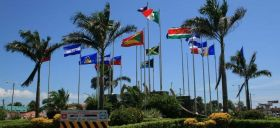 flags raised in government office in Belize  – Best Places In The World To Retire – International Living