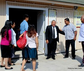 Pastor Rafael Gomez welcoming people to church – Best Places In The World To Retire – International Living
