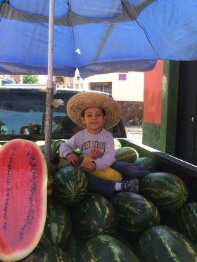 Boy sitting in a truck with watermelons in Ajijic – Best Places In The World To Retire – International Living