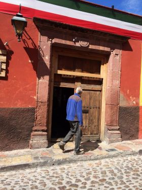 Chuck Bolotin walking on a street in San Miguel de Allende – Best Places In The World To Retire – International Living