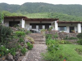 House in Jocotepec with mountains in the background – Best Places In The World To Retire – International Living