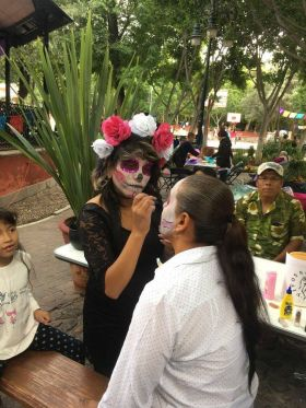 Woman putting on makeup for Day of the Dead San Miguel de Allende – Best Places In The World To Retire – International Living