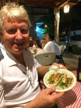 Man eating a taco in Nayarit, just north of Puerto Vallarta, Mexico – Best Places In The World To Retire – International Living