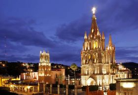 San Miguel de Allende with parroquia lit at night – Best Places In The World To Retire – International Living