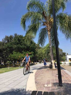 Riding a  bike along the malecon in Lake Chapala – Best Places In The World To Retire – International Living