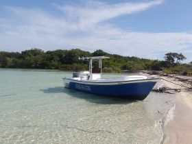 Boat belonging to Josh Buettner's company, Ambergris Seaside Realty, Ambergris Caye, Belize – Best Places In The World To Retire – International Living