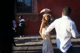 Bride and groom walking the streets of San Miguel de Allende, Mexico – Best Places In The World To Retire – International Living