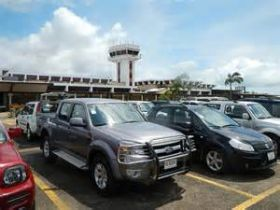 Cars in parking lot of Belize International Airport – Best Places In The World To Retire – International Living