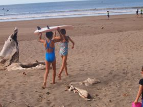 Children head off to surf from San Juan del Sur Day School, San Juan del Sur, Nicaragua – Best Places In The World To Retire – International Living