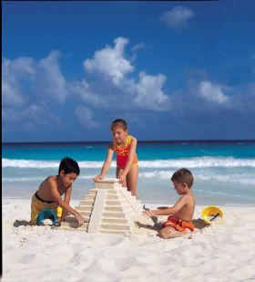 Children building a Mayan temple on the beach at Cancun, Mexico – Best Places In The World To Retire – International Living
