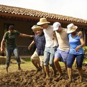 Cubita Development staff building a mud house for a neighbor, Chitre, Panama – Best Places In The World To Retire – International Living