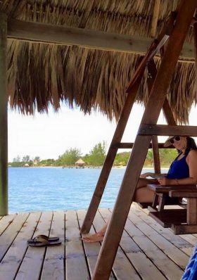 Enjoying the covered deck swing at Vision Properties, Placencia, Belize – Best Places In The World To Retire – International Living