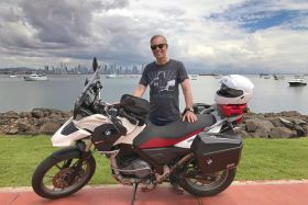 Expat Christophe Frochaux  with his bike, Panama City, Panama – Best Places In The World To Retire – International Living