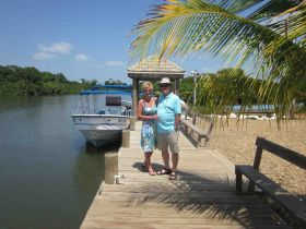 Friends of Howard and Wilana Oldham on a dock in Hopkins Caye, Belize – Best Places In The World To Retire – International Living