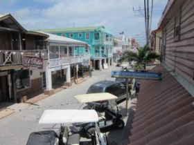 Golf carts parked along businesses in San Pedro, Ambergris Caye, Belize – Best Places In The World To Retire – International Living
