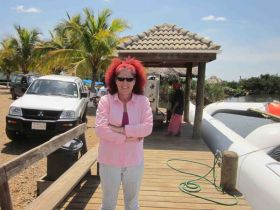 Howard Oldham's wife at dock on Hopkins, Belize – Best Places In The World To Retire – International Living