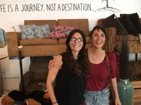 Magy Cardona (right) shows Jet Metier of Best Places in the World to Retire, some furniture options at her resale store Make It Cash, Ajijic, Mexico – Best Places In The World To Retire – International Living