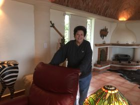Susie Ozman with her comfortable living room, Rancho Los Labradores, San Miguel de Allende, Mexico – Best Places In The World To Retire – International Living