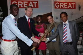 Foreign Office Minister Jeremy Browne with the Belize Olympic team Kenneth Medwood, Kaina Martinez and Eddermys Sanchez – Best Places In The World To Retire – International Living