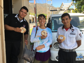 Jet Metier of Best Places in the World to Retire giving seasonal pastry to the security guards, Lake Chapala, Mexico – Best Places In The World To Retire – International Living