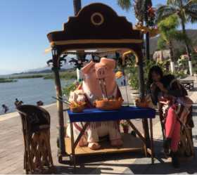 Jet Metier of Best Places in the World to Retire sampling a drink appetizer on the malecon of Lake Chapala, Mexico – Best Places In The World To Retire – International Living