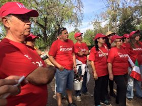 Keller William volunteers gather to earase graffiti in San Miguel de Allended, Mexico – Best Places In The World To Retire – International Living
