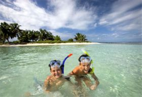 Kids enjoying the Caribbean off the private island belonging to The Placencia, Placencia, Belize – Best Places In The World To Retire – International Living