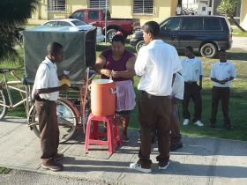 Kids buying juice before school in Belize City, Belize – Best Places In The World To Retire – International Living