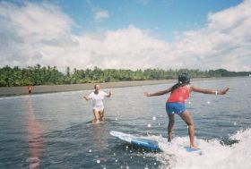 Kristin Wilson teaching orphans to surf – Best Places In The World To Retire – International Living