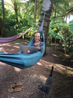Kristin Wilson working on her laptop in a hammock – Best Places In The World To Retire – International Living