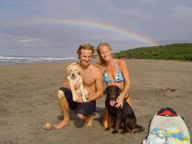 Lance and Kristin Moss with their dogs on the tranquili beach,  Playa Guasacate, in Popoyo , north of San Juan del Sur, Nicaragua – Best Places In The World To Retire – International Living