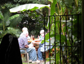 Linda Jensen dining in a patio with banana tree – Best Places In The World To Retire – International Living