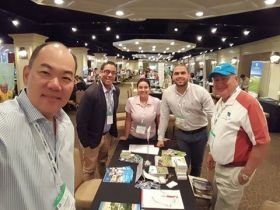 Representives from Tucan Golf Course and Resorts  promoting their property as a yearlong golf destination at an international convention – Best Places In The World To Retire – International Living