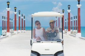 Riding a golf cart along the white sand beaches and pier near Peten development in Sisal, Yucatan, Mexico – Best Places In The World To Retire – International Living