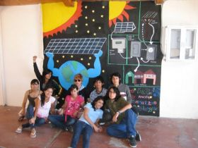 Students in front of a roof top solar panel mural in La Paz, Mexico – Best Places In The World To Retire – International Living