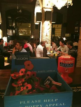 The George Pub  celebrates fallen British solideris with poppies in Lisboa, Portugal – Best Places In The World To Retire – International Living