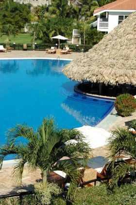The garden around the swim- up pool bar The Placentia, Placencia, Belize – Best Places In The World To Retire – International Living