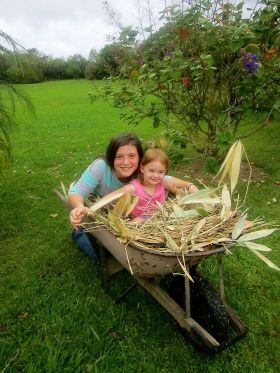 The Gilbert girls gather leaf matter from their property for their chicken coop, Volcan, Panama – Best Places In The World To Retire – International Living