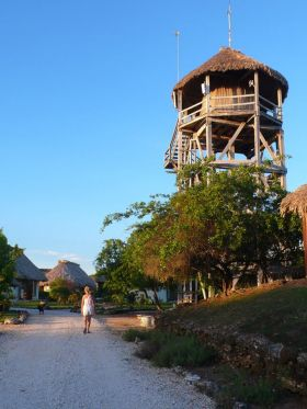 The water tower and guest houses at Crimson Orchid Inn, near Corozal, Belize – Best Places In The World To Retire – International Living