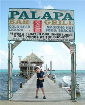 boy on dock in Ambergris Caye – Best Places In The World To Retire – International Living