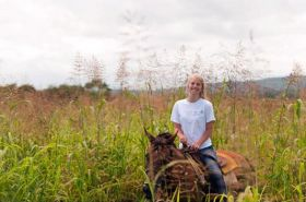 girl riding a horse in Cayo District, Belize – Best Places In The World To Retire – International Living