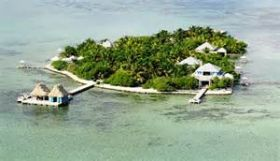 private island  with huts over the water, Belize – Best Places In The World To Retire – International Living