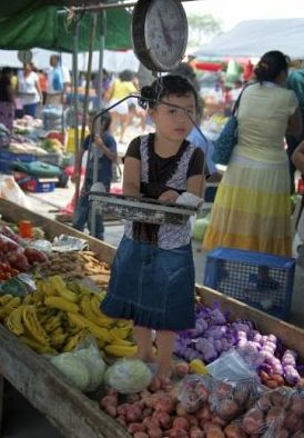 Young girl at farmer's market in Belize – Best Places In The World To Retire – International Living